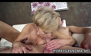 Heeled grandma sucks dick
