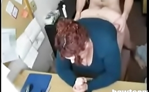 Chubby Redhead Receives Her Hole Filled at the Office